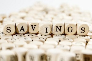 Savings spelled out with game pieces