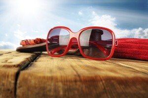 Summer Glasses on wood with towel and slippers