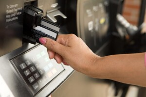 Swiping a credit card reader at gas pump
