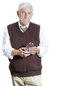 Older man cautiously holiding his wallet