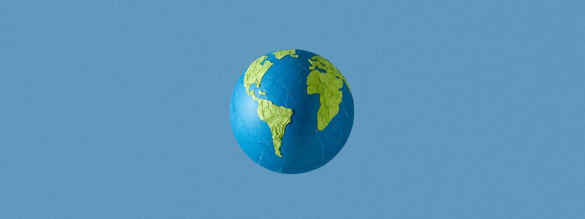 paper mache globe on blue background