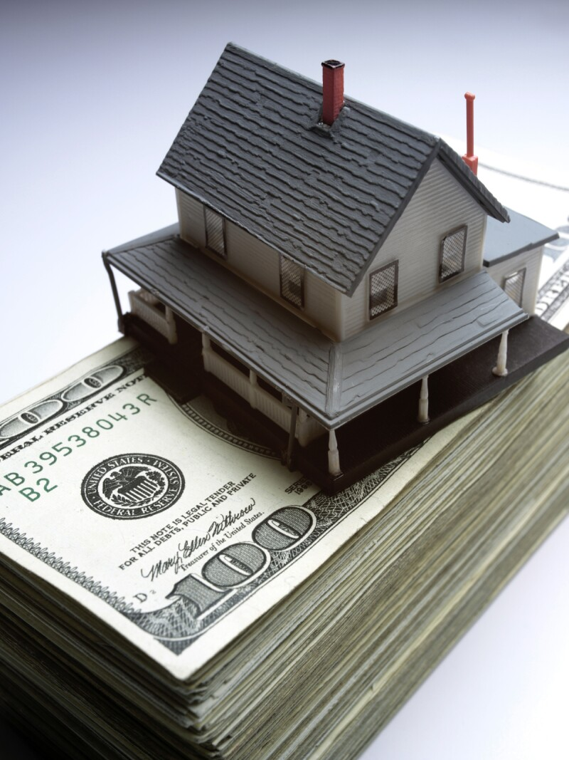 iStock_000001075147Medium house on money