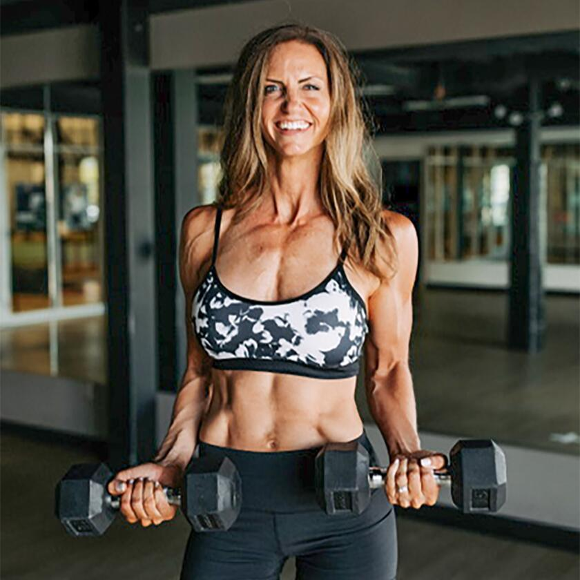 Jessica Gunn works out with dumbbells.