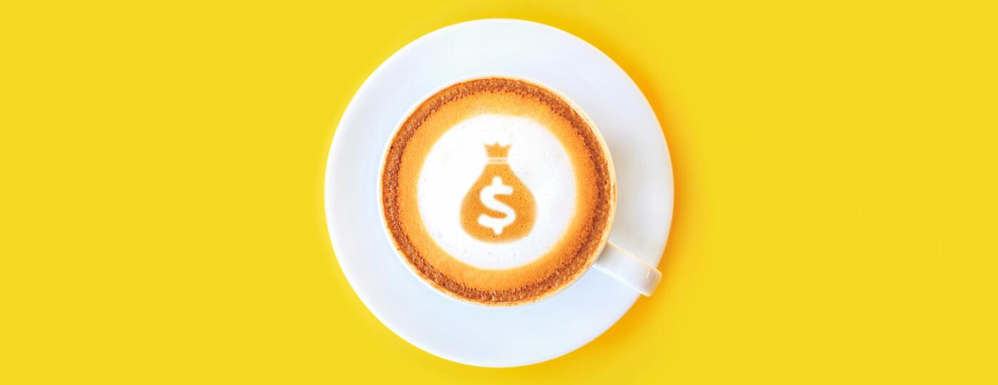 latte with dollar sign and money bag made out of the foam