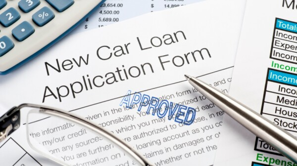 Approved Car loan application Form with pen, calculator