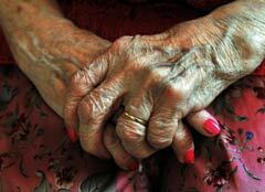 240-senior-person-hands-red-nails