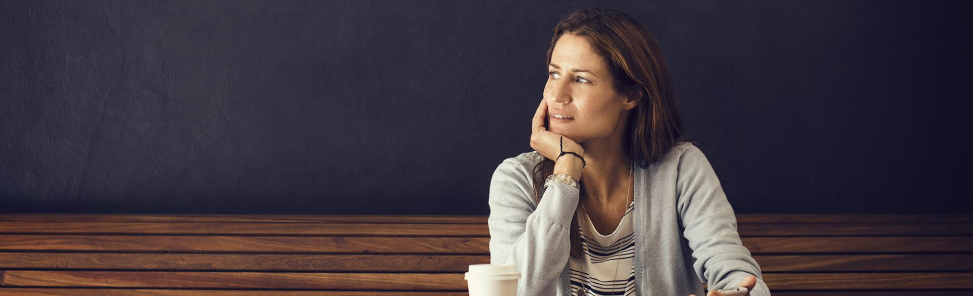 woman sitting alone at coffee shop