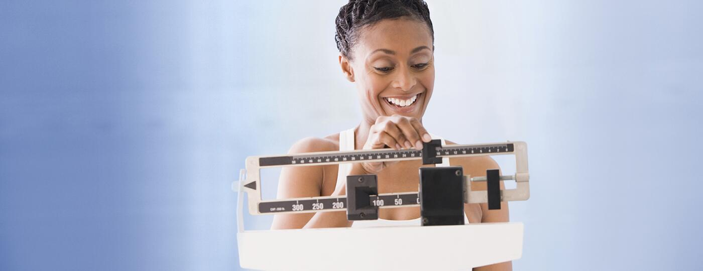 image_of_woman_weighing_herself_on_a_scale_GettyImages-77147010v2_1800
