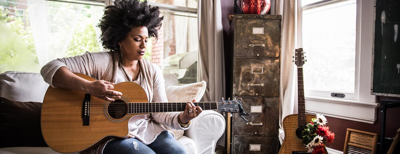 image_of_woman_playing_the_guitar_GettyImages-694757290_1800