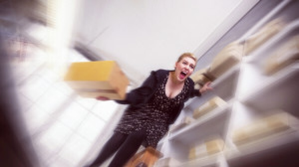 Office worker screams in sheer terror as she slips off a ladder.