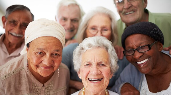 A group of diverse seniors smile