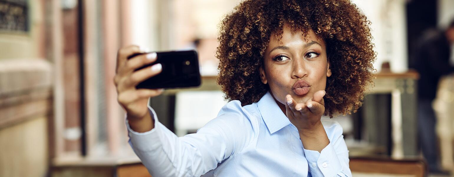 image_of_african_american_woman_taking_selfie_with_phone_GettyImages-946920772_1540