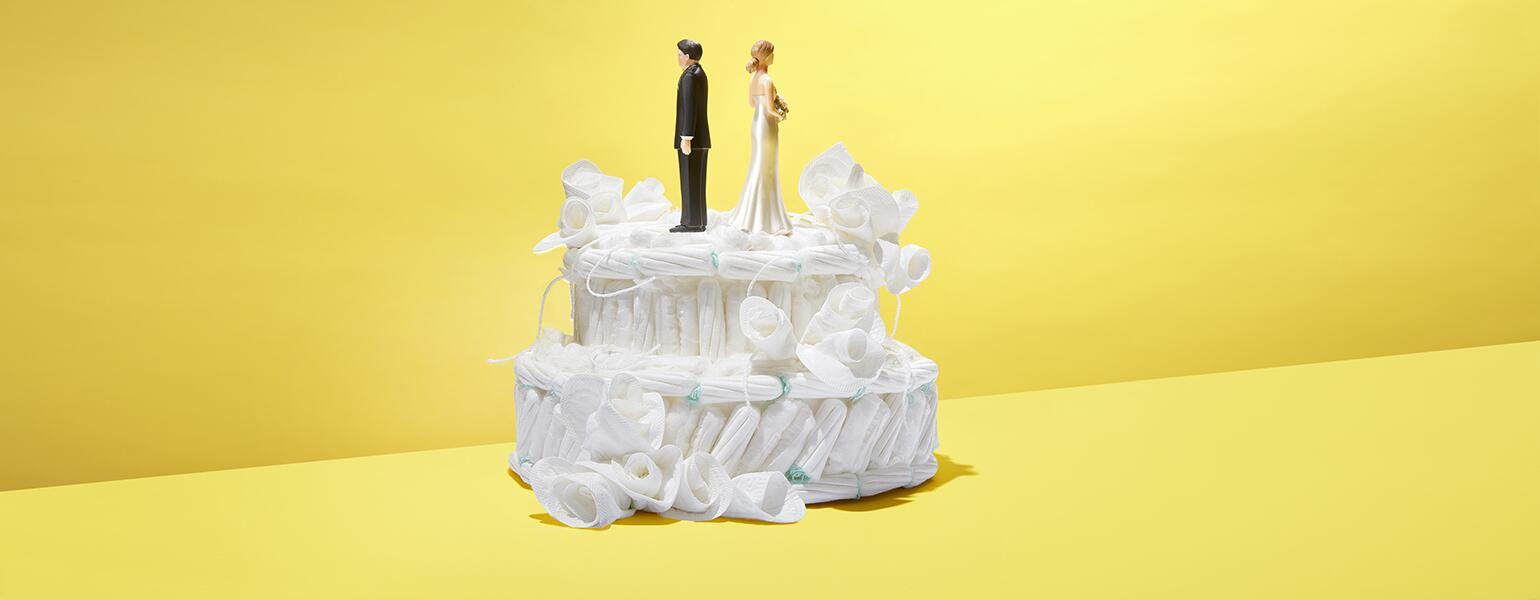 Wedding cake made out of tampons with bride and groom figurines on top.
