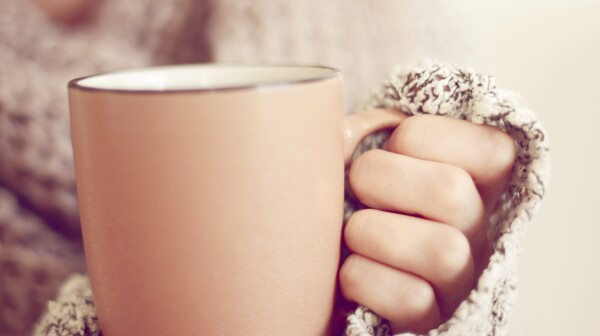 close-up of woman's hands holding a mug