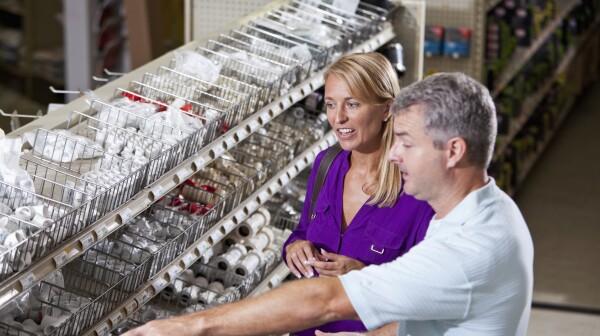 Worker in hardware store helping customer