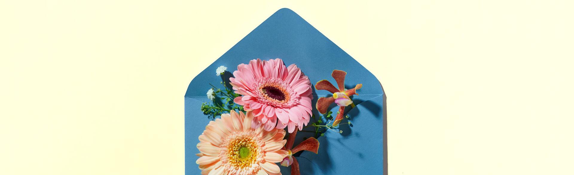 Blue Envelope Full Of Various Flowers.
