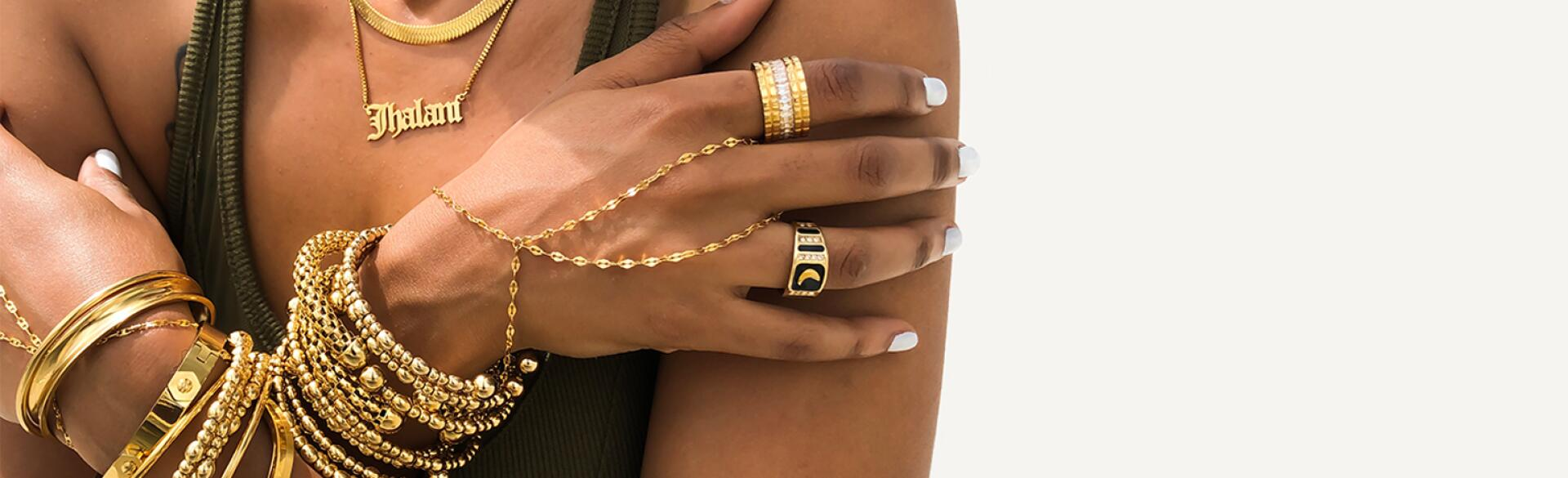 Black woman with layers of gold jewelry