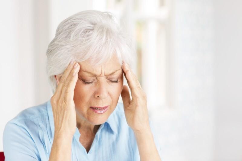 Senior Woman With Headache.