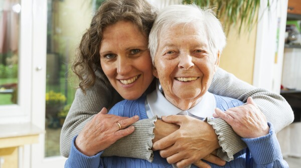 mature woman embracing senior woman