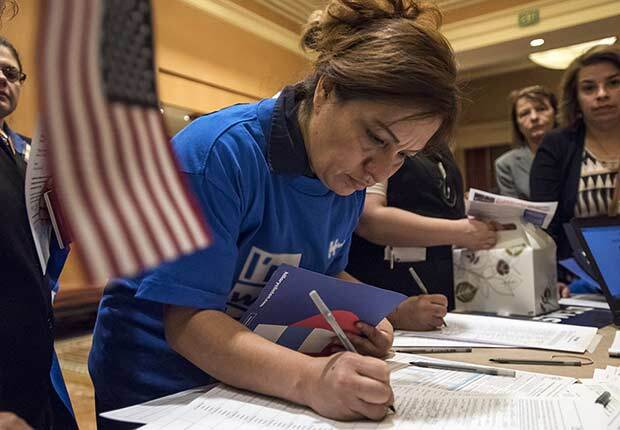 Caucusgoers check-in before casting their vote for a Democratic presidential candidate ahead of the Nevada Democratic presidential caucus at Caesar's Palace in Las Vegas, Nevada, U.S., on Saturday, Feb. 20, 2016. Today voters weigh in on the Democratic battle between Hillary Clinton and Bernie Sanders competing in the Nevada caucuses with Clinton believed to have the advantage in the western state because of its heavily Hispanic electorate, but some recent polls show the race tied.