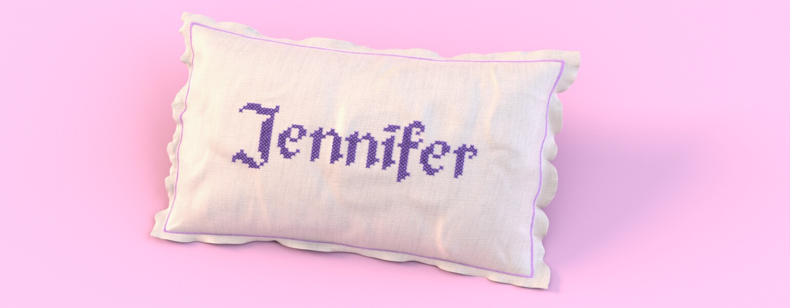 image of the name  jennifer stitched on a pillow by the girlfriend staff