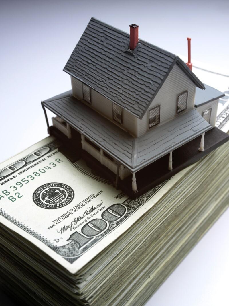 iStock_000001075147Medium house on money