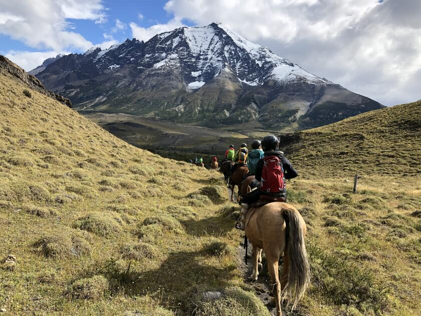 A group goes horseback riding with Women's Quest.