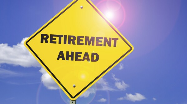 "Yield sign that reads ""retirement ahead"""