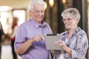 Senior Couple Using Electronic Tablet