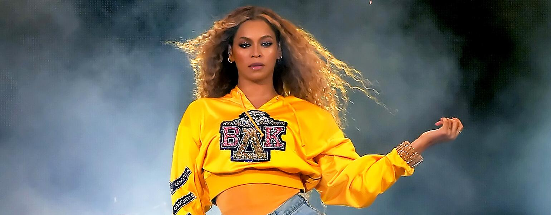 Beyonce performing at Coachella wearing college sweatshirt
