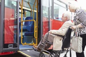 Senior couple boarding bus