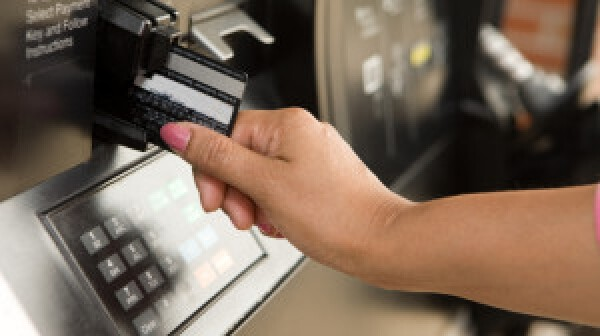 Swiping a credit card reader at gas pump