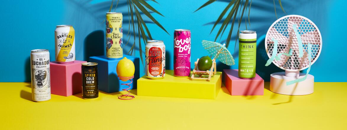 7 canned cocktails on a colorful background