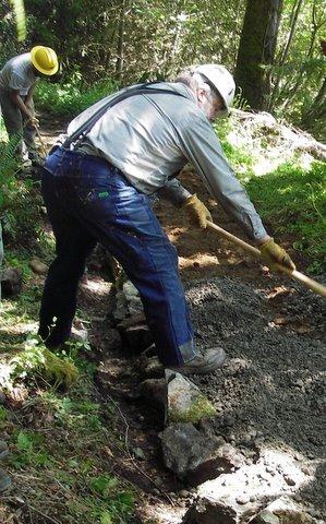 Volunteer works the soil