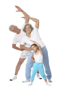 Grandparents with little girl Exercising On White Background