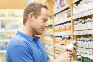 Man choosing OTC products at store