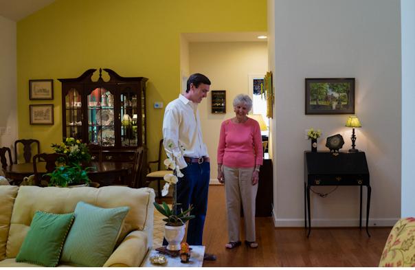 Linda Broadbent shows developer Charlie Armstrong her EasyLiving Home.