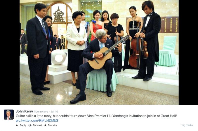 John Kerry plays guitar for diplomats