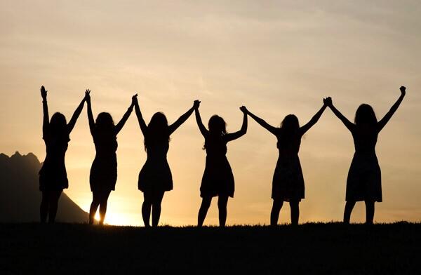 Group of women holding  hands -- AARP