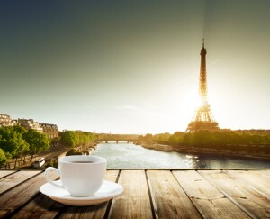 Coffee on Table and Eiffel Tower in Paris