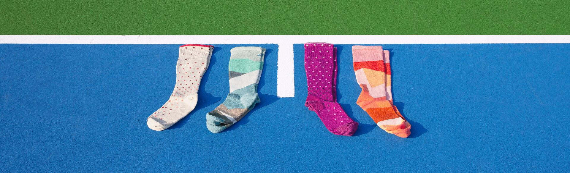 compression socks photographed on a blue tennis court