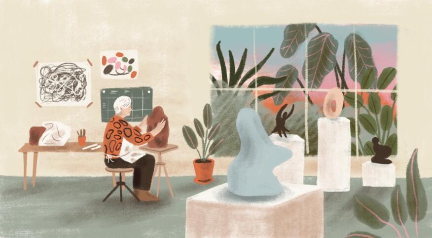 Woman sculpting around paintings