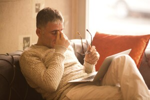 Stressed out man with laptop