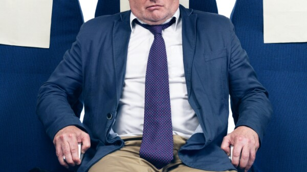 Worried man in airplane seat