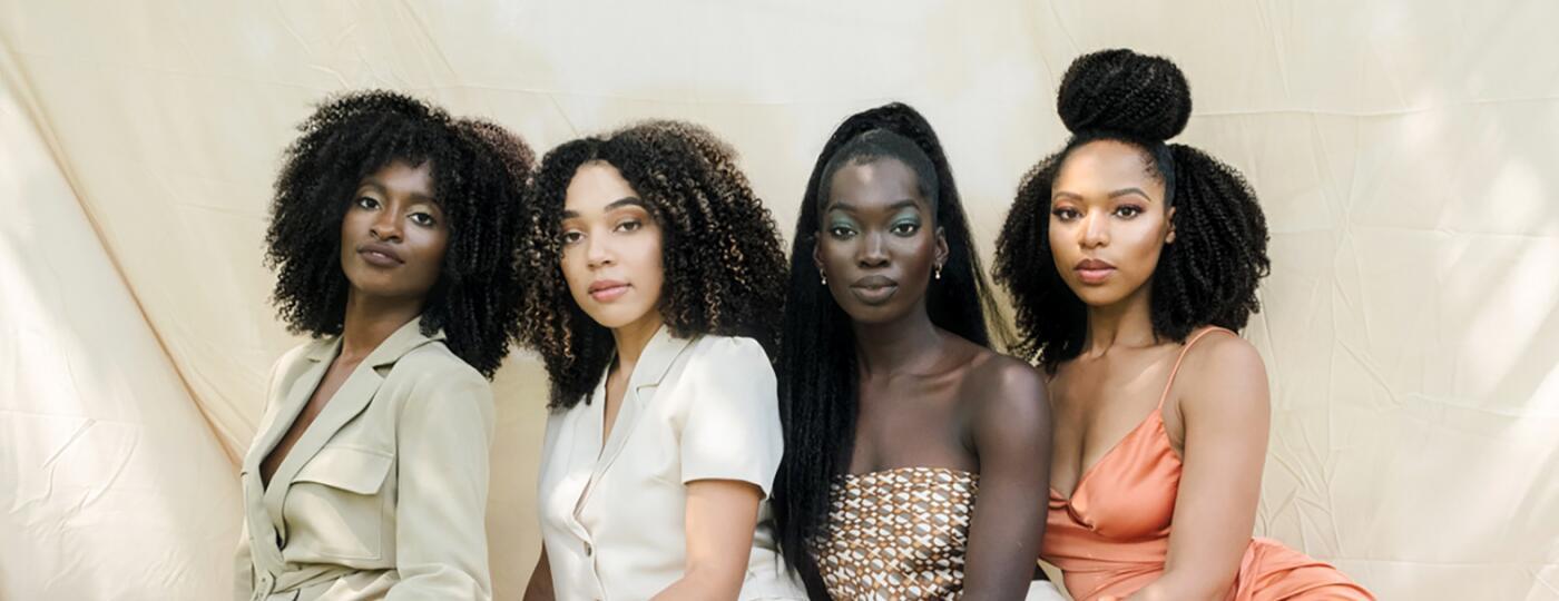 image_of_four_women_posing_wearing_natural_wigs_Banner-3_1800.jpg