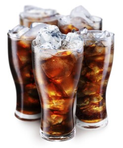 Four glasses of cola on ice