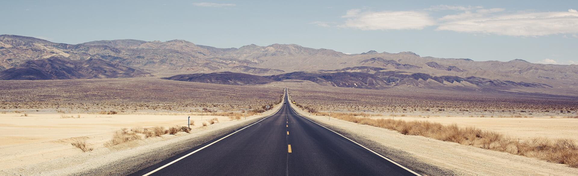 Empty road in the desert representing loneliness.