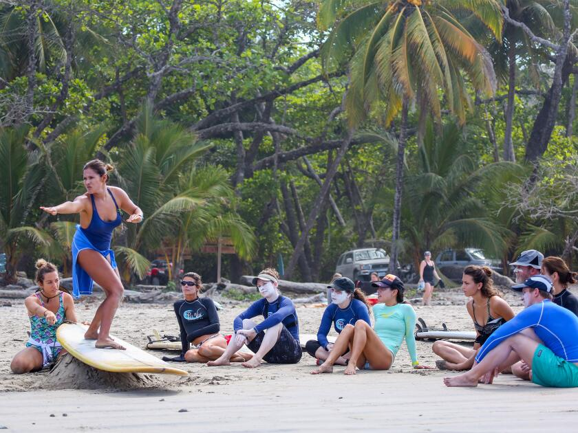 A group learns to surf with Pura Vida Adventures.