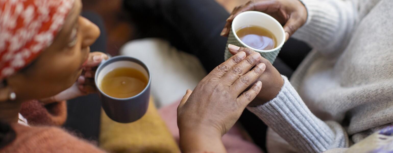 Women friends talking, drinking tea