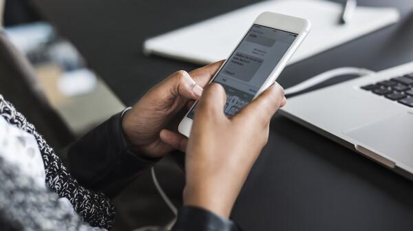 woman texting at work